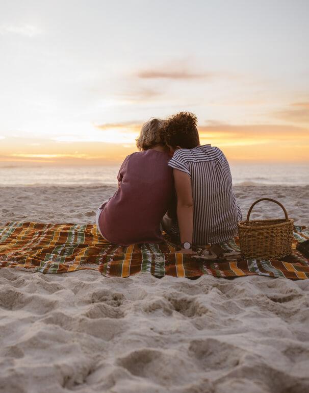 Couple picnics on the beach